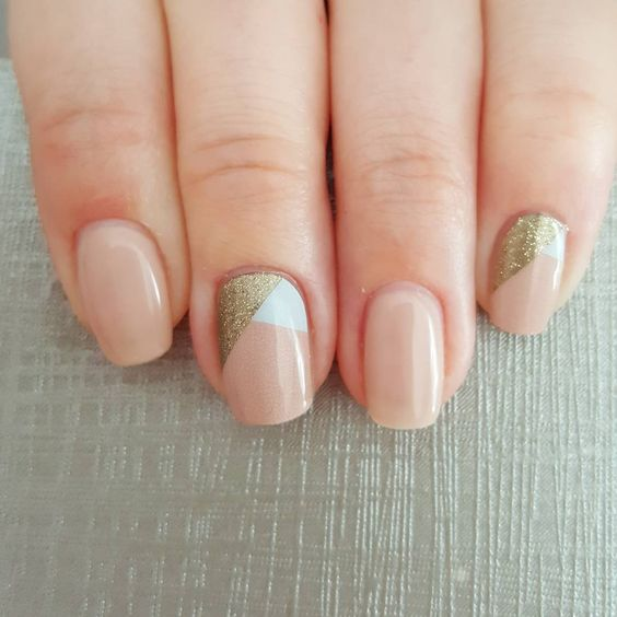 nude nails and color block white and gold glitter accent nails for a contemporary geometric touch