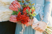 07 The wedding bouquet was done with king proteas, berries and red roses