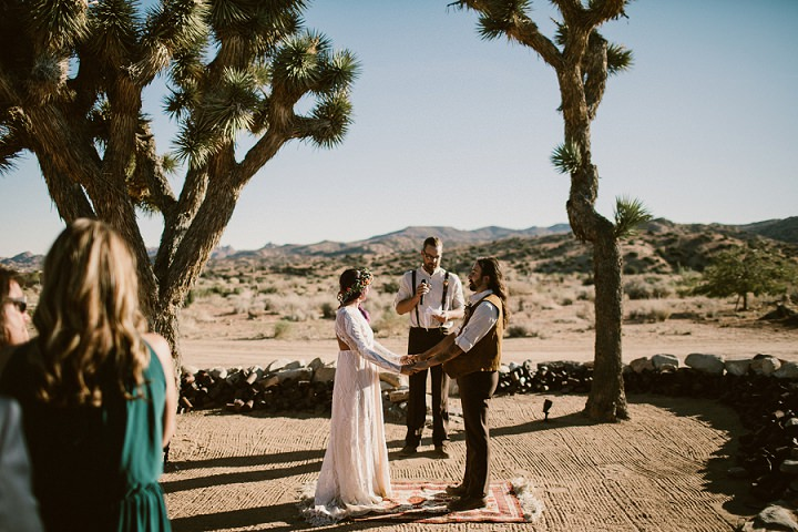 The wedding ceremony took place under two trees and was decorated with rugs
