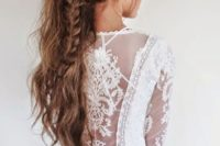 07 a boho messy ponytail with a large braid incorporated in it