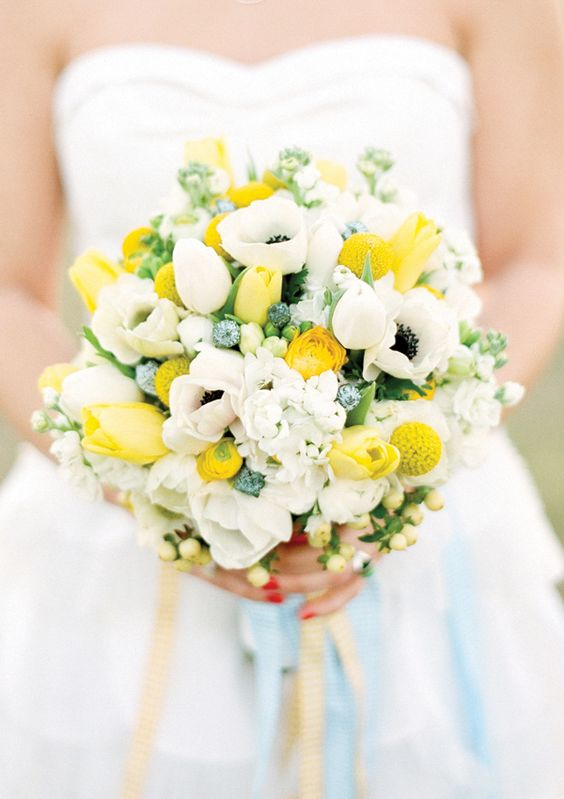 a bridal bouquet with white anemones, tulips, billy balls and ranunculus