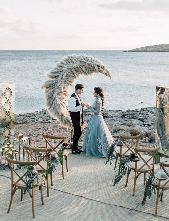 a pampas grass crescent moon wedding backdrop looks out of this world and really fantastic