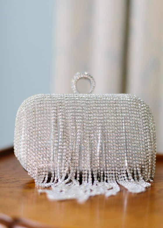 a super sparkling art-deco inspired wedding clutch with rhinestone fringe that covers it completely