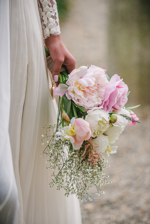 The bridal bouquet was a DIY one, with blush and ivory blooms and baby's breath
