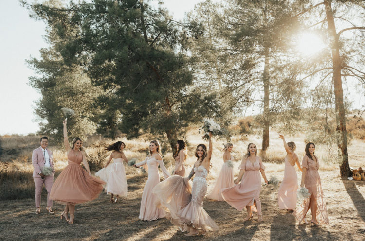 The bridesmaids were rocking mismatching dresses in blush and dusty pink tones