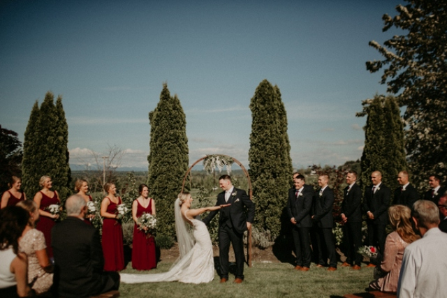 The wedding ceremony space was done with a wooden arch with florals and elegantly cut trees