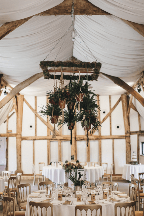 The wedding venue was a neutral and rustic one, with beams and ethereal fabrics and hanging greenery