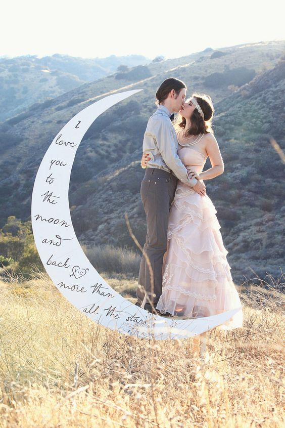 a crescent moon poetry backdrop with a bench for taking wedding pics