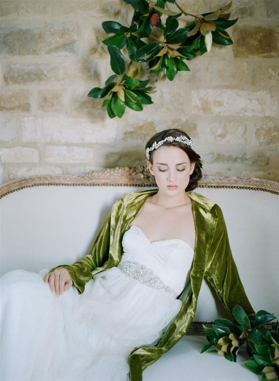 a statement embellished belt and a jeweled tiara for a glam feel in the bridal look