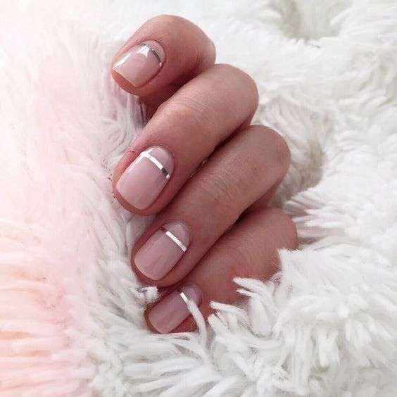 nude glossy nails with metallic stripes for a modern accent - a chic idea to make your nails catchy