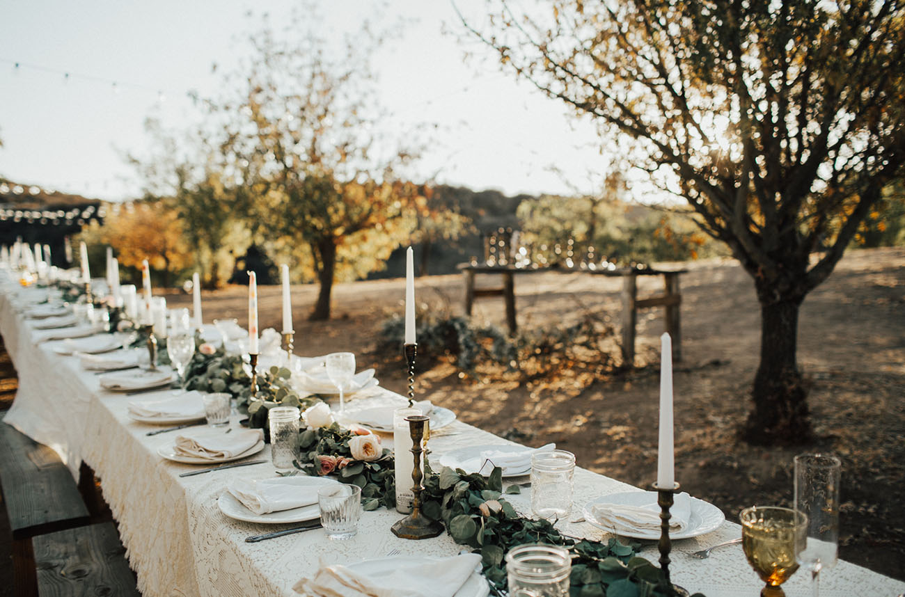 The wedding reception was done with a family styled table with a greenery and blush flower runner plus candles