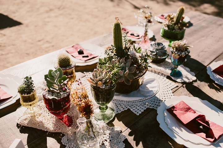 The wedding tables were decorated with succulents, cacti and macrame doilies