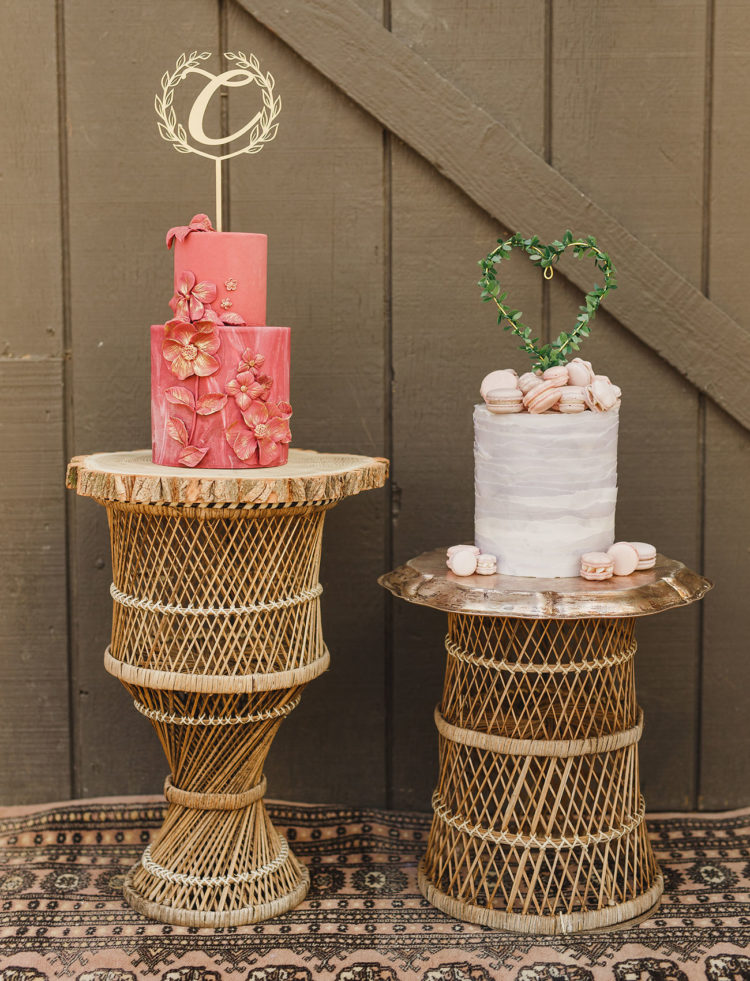 There were two different wedding cakes - a pink watercolor one with sugar flowers and a white buttercream one with macarons