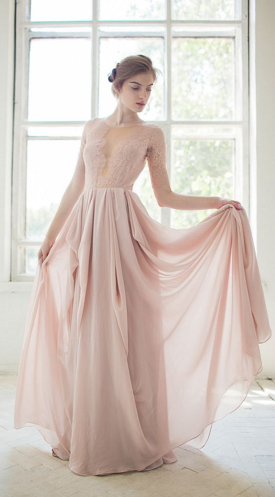a dusty pink wedding gown with a lace bodice, an illusion plunging neckline, long sleeves and a layered skirt