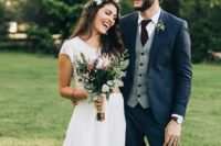 09 a navy suit with a grey vest, a plum-colored tie and a boutonniere is a classic vintage look