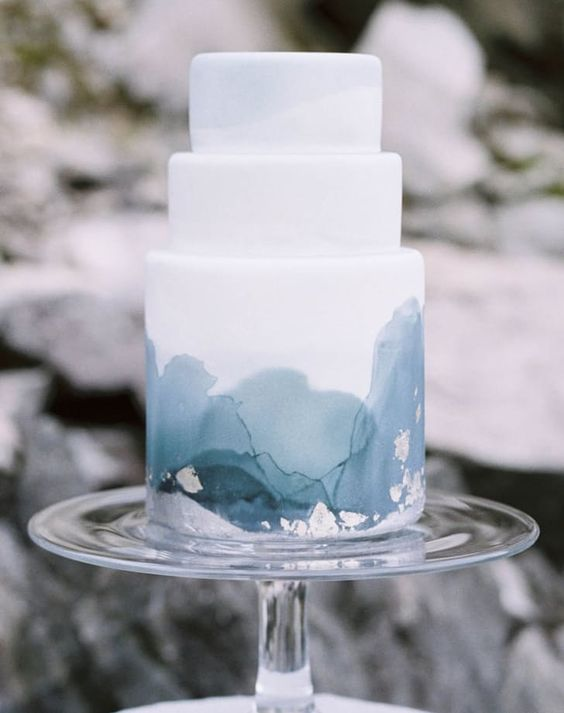 a watercolor blue grey wedding cake for a modern coastal wedding