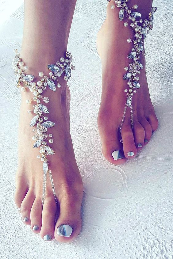 barefoot beach wedding shoes and a metallic pedicure to match