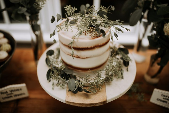The wedding cake was a naked one topped with fresh eucalyptus