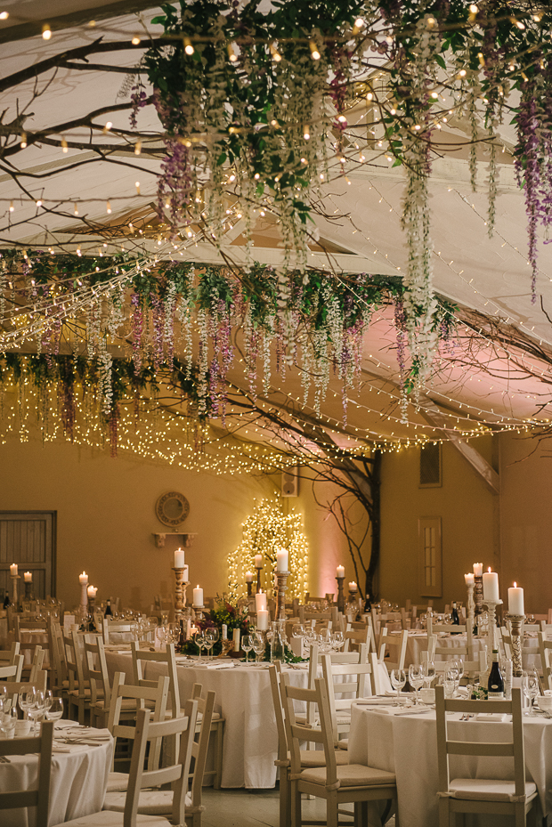 The wedding venue was done with hanging fairy lights and flowers and looked really magical