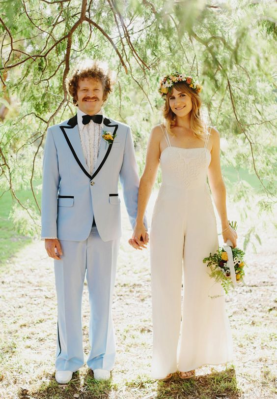 a lace bridal jumpsuit on double spaghetti straps and with wide pants plus a floral crown for a retro look