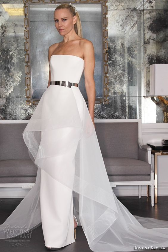 a minimalist wedding dress accentuated with a shiny metallic belt looks wow