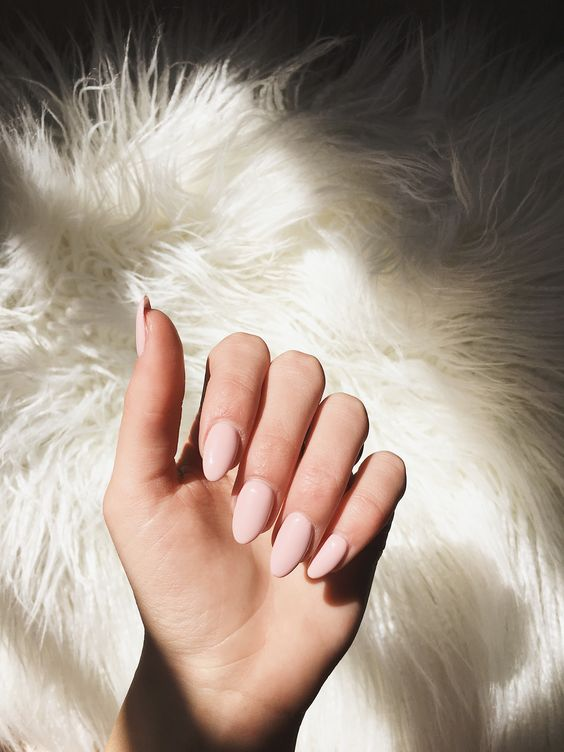 matte blush almond-shaped nails are a stylish idea that will fit any bridal look