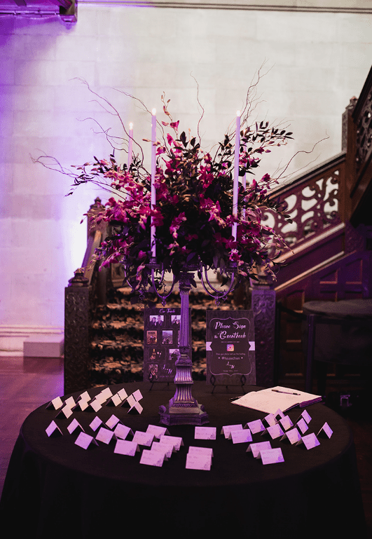 Every detail of the wedding was refined, even the seating chart with candlelabra and refined florals