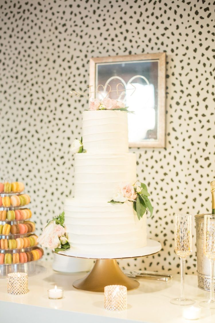 The wedding cake was a buttercream one, with blush and ivory blooms and an arrow topper