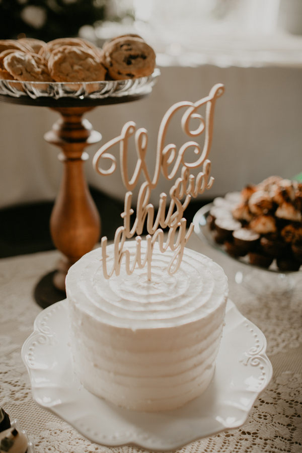 The wedding cake was a white buttercream one with a calligraphy topper
