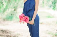 11 a blue one shoulder jumpsuit with red shoes and a statement necklace for a bright look