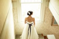 11 a bride wearing a deep purple velvet wedding sash for a colorful touch and to highlight the waist