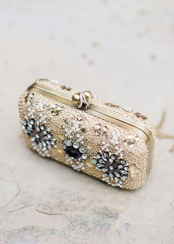 a jeweled bridal purse with gold and clear beads and rhinestones is a perfect glam statement