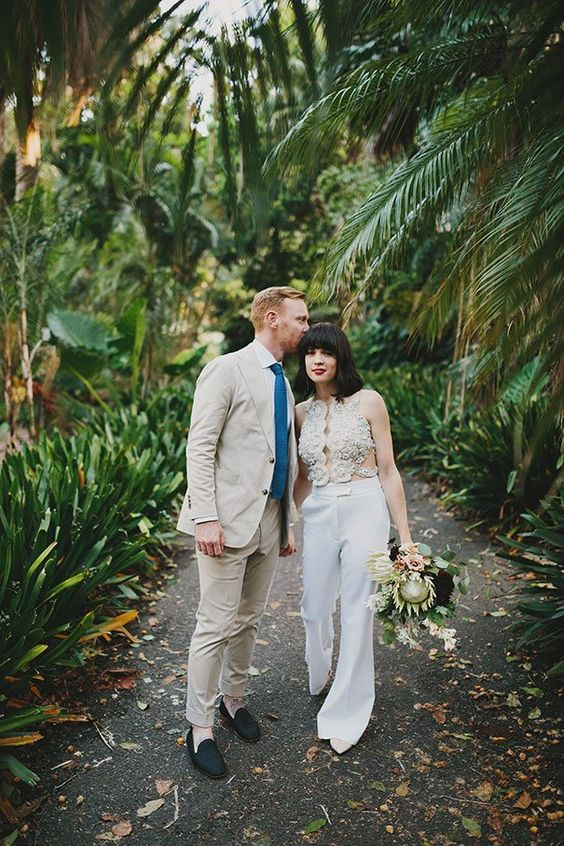 a unique jumpsuit with a gorgeous cutout ivory lace and beads bodice and plain pants
