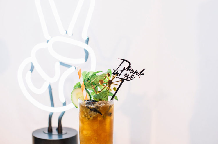 Neon signs, mid-century drink stirrers were included into the wedding decor