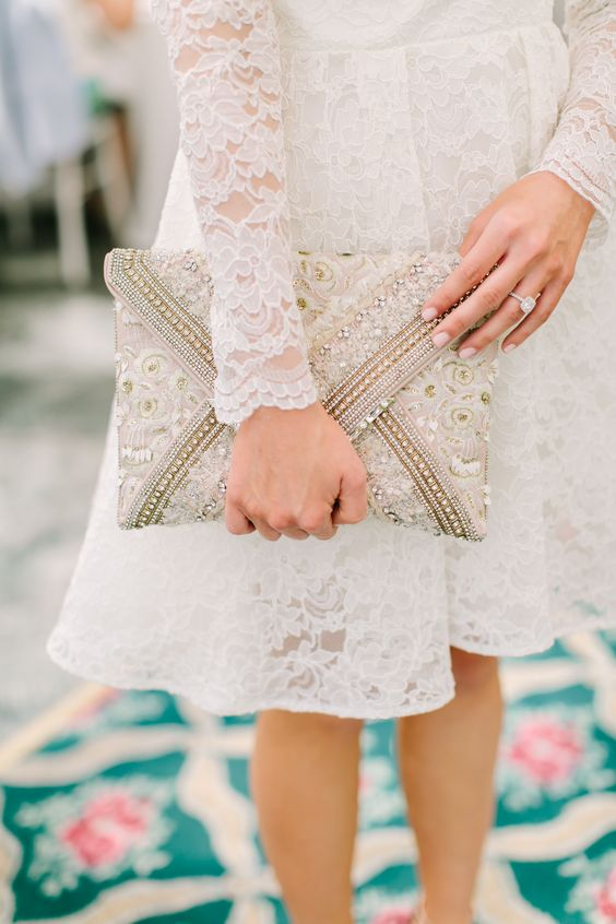 a beaded wedding clutch with lace is ideal for a romantic bride and brings a glam touch