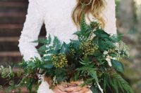 12 a heavily embellished high neckline long sleeve wedding dress and a lush textural greenery bouquet with berries