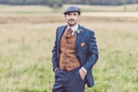 12 a navy windowpane wedding suit, a brown vest, a vintage tie and a cap for a styled look