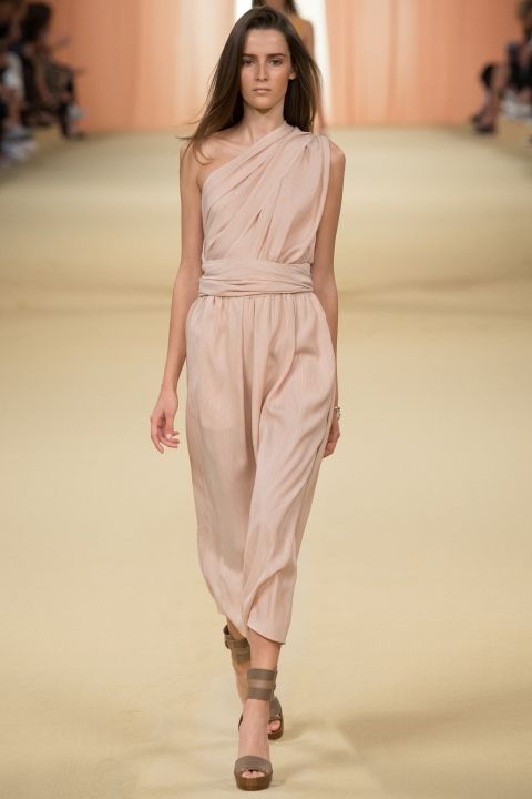 a nude one shoulder bridesmaid's jumpsuit with cropped pants and stappy shoes