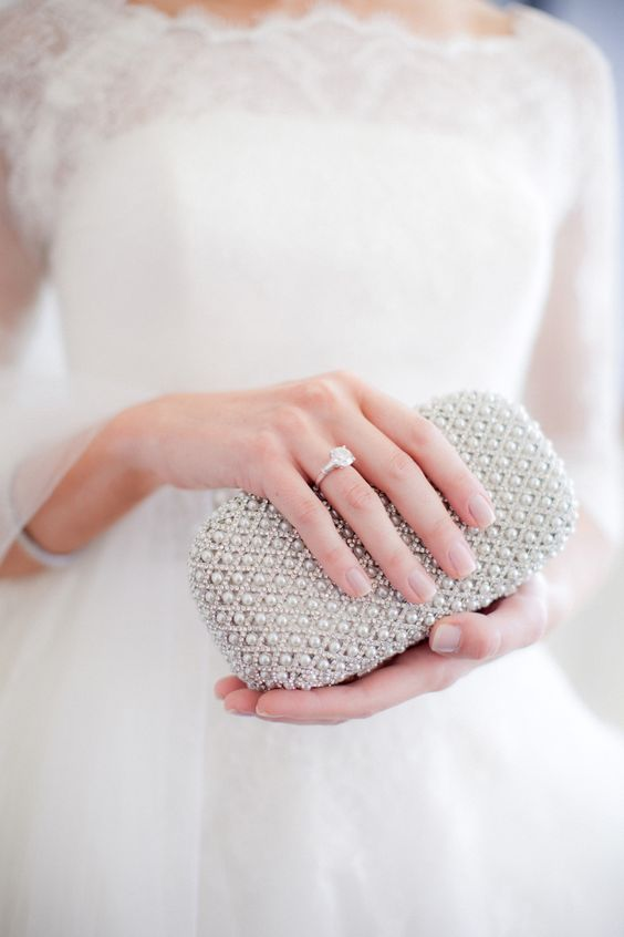 a beaded and pearled little clutch is a gorgeous modern way to rock pearls at a wedding