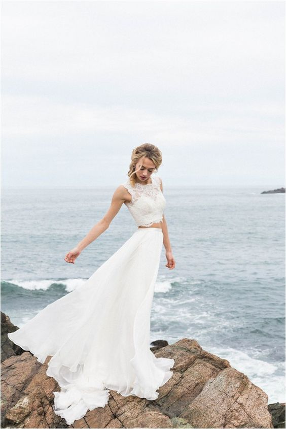 a bride wearing a separate with a sleeveless lace crop top and an A line ruffled skirt