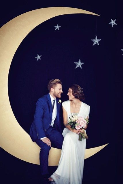 a crescent moon and stars wedding photo booth backdrop can be DIYed