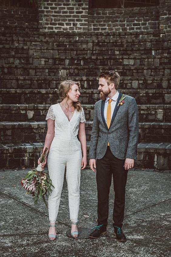 a lace bridal jumpsuit with cap sleeves, a V-neckline and narrow pants plus mint heels