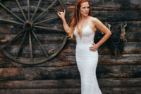 13 a super sexy lace mermaid wedding dress with a plunging neckline and spaghetti straps
