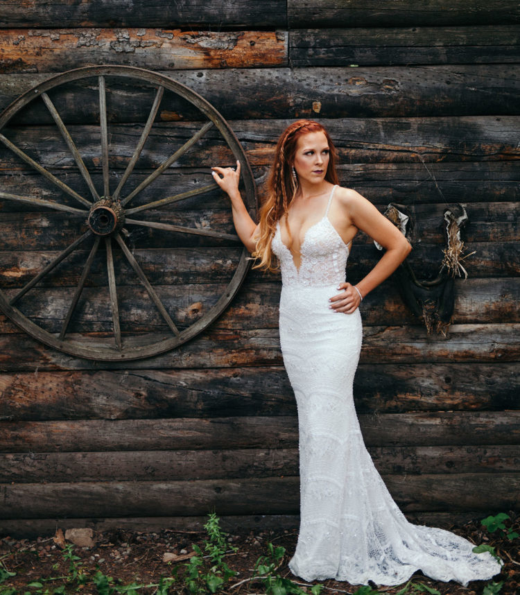 a super sexy lace mermaid wedding dress with a plunging neckline and spaghetti straps