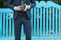 13 a vintage checked navy suit with a vest, a black bow tie and cognac shoes for a stylish look