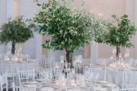 13 a white reception space done with lush and textural greenery centerpieces