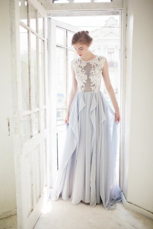 a cap sleeve wedding dress with a lace bodice and a layered light blue skirt looks ethereal