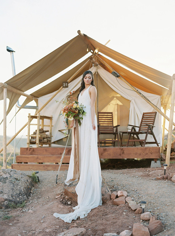 a flowy thick strap halter neckline wedding dress with a V-neckline, an airy skirt and a train for a boho wedding