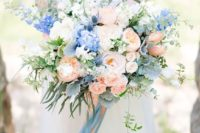 14 a lush peachy pink and blue wedding bouquet with long ribbons for a bold summer look