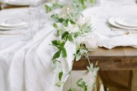 14 a subtle fresh greenery table runner and some candles to add charm to the table